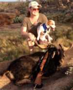 rifle catalina goat hunt with dog in hill country land